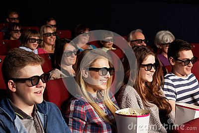 Teenage Friends Watching 3D Film In Cinema