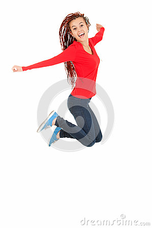 Teenage girl in african hairdo jumping with joy
