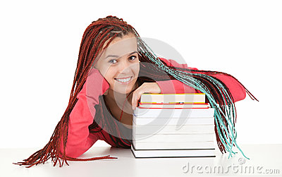 Teenage girl with african hairdo and pile of books