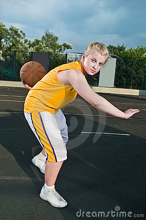 Teenage girl with basketball