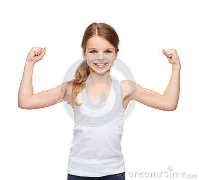 Teenage girl in blank white shirt showing muscles