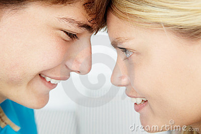 Teenage girl and boy with the heads touching