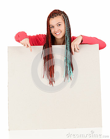 Teenage girl with braids pointing on blank board