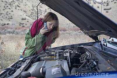 Teenage girl with a broken car