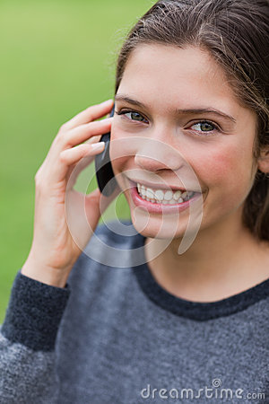 Teenage girl calling with her mobile phone
