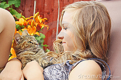 Teenage girl with cat