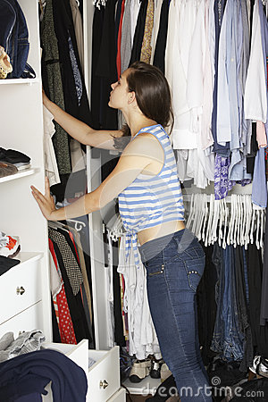 Free Teenage Girl Choosing Clothes From Wardrobe In Bedroom Royalty Free Stock Images - 54966959