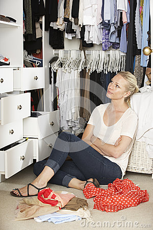 Free Teenage Girl Choosing Clothes From Wardrobe In Bedroom Royalty Free Stock Images - 55895589