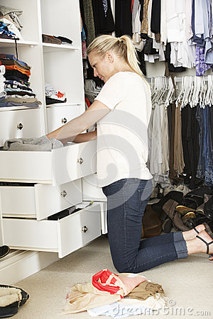 Free Teenage Girl Choosing Clothes From Wardrobe In Bedroom Royalty Free Stock Image - 55896106