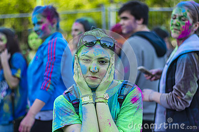 Teenage girl covered in green powder Editorial Stock Image