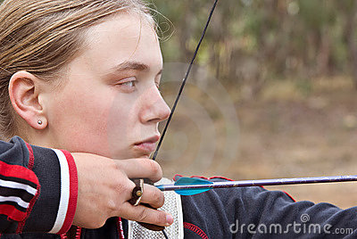 Teenage girl doing archery