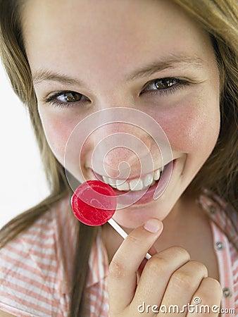 Teenage Girl Eating Lollipop