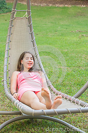 Free Teenage Girl Enjoying An Outdoor Hammock Stock Photo - 60323690