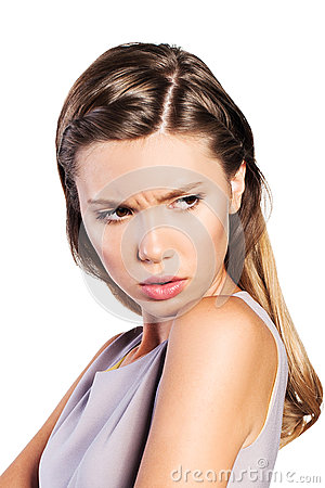 Teenage girl expressing dissatisfied emotion