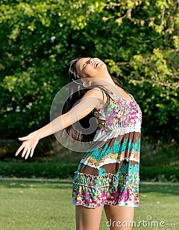 Teenage Girl Expressing Joy In The Sunshine