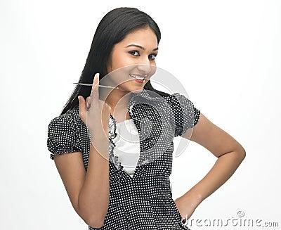 Teenage girl finger with CD