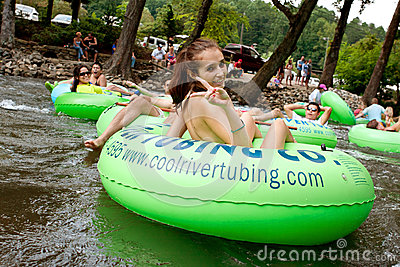 Teenage Girl Flashes Peace Sign While Tubing Down Georgia River Editorial Image