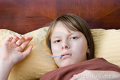 Teenage girl flu sick in bed measuring temperature