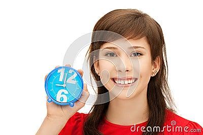 Teenage girl holding alarm clock Stock Photo