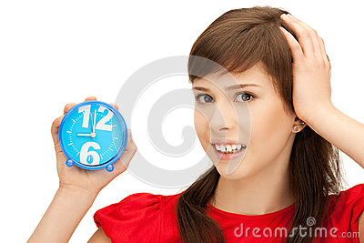 Teenage girl holding alarm clock Stock Photo