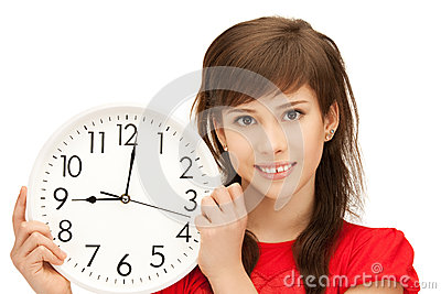 Teenage girl holding big clock Stock Photo