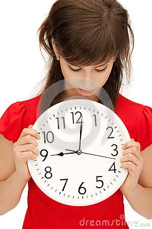 Teenage girl holding big clock Stock Photo