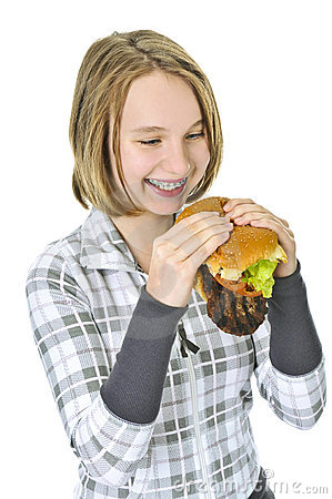 Teenage girl holding big hamburger