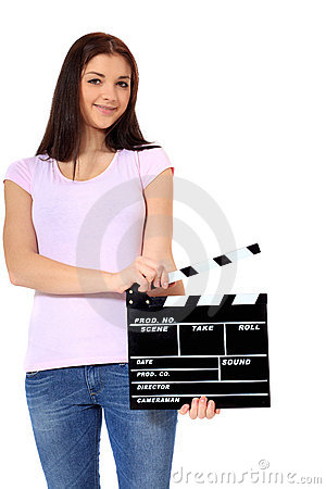 Teenage girl holding clapperboard