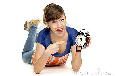 Teenage girl holding clock