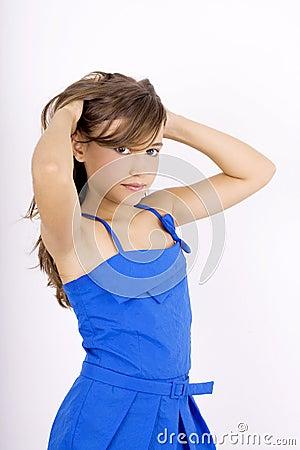 Teenage girl holding her hair