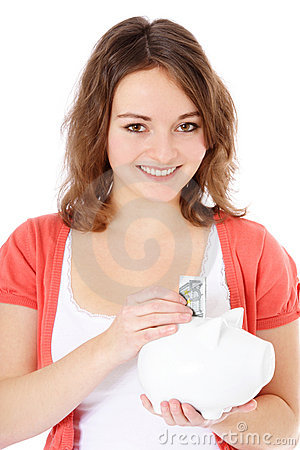 Teenage girl holding piggy bank