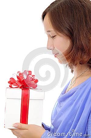 Teenage girl holding a present