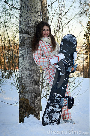 Teenage girl holding snowboard