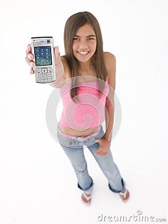 Teenage girl holding up cellular phone