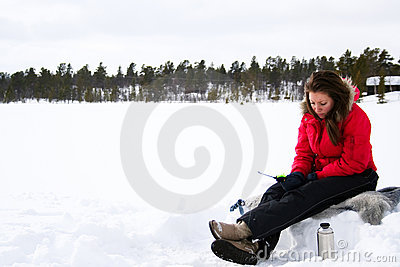 Teenage girl ice fishing