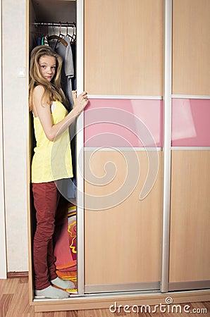 Free Teenage Girl In Wardrobe At Home Stock Image - 28546961