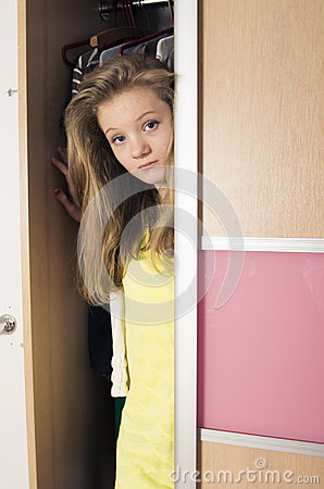 Free Teenage Girl In Wardrobe At Home Stock Images - 28547034