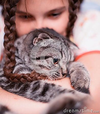 Teenage girl with kitten