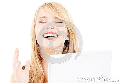 Teenage girl with laptop computer