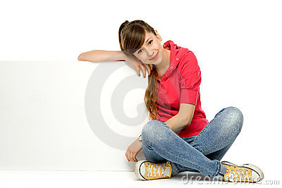 Teenage girl leaning on blank poster