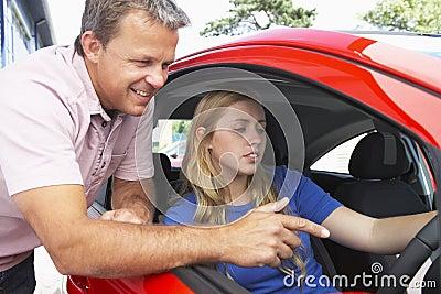 Teenage Girl Learning How To Drive