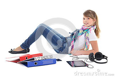 Teenage girl listening music with tablet pc