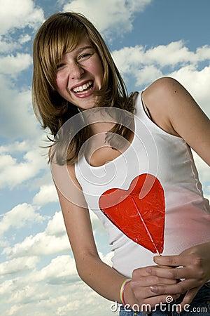 Teenage girl with lollipop