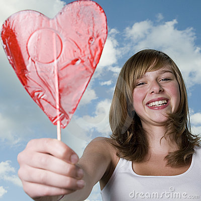 Teenage girl with lollipop