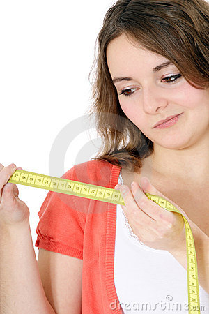 Teenage girl looking at measuring tape
