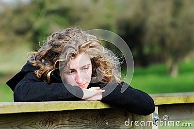 Teenage girl looking thoughful
