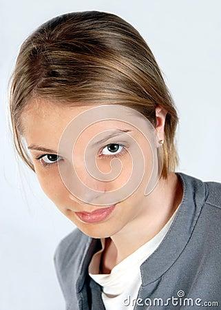 Teenage girl looking upward business attire