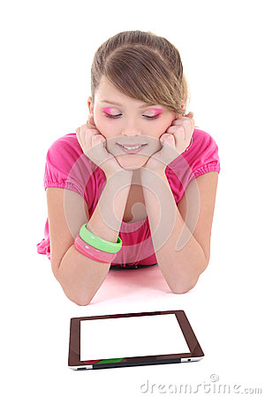 Teenage girl lying and using tablet pc