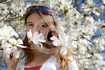 Teenage girl in magnolia flowers