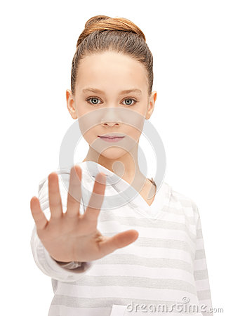 Teenage girl making stop gesture Stock Photo